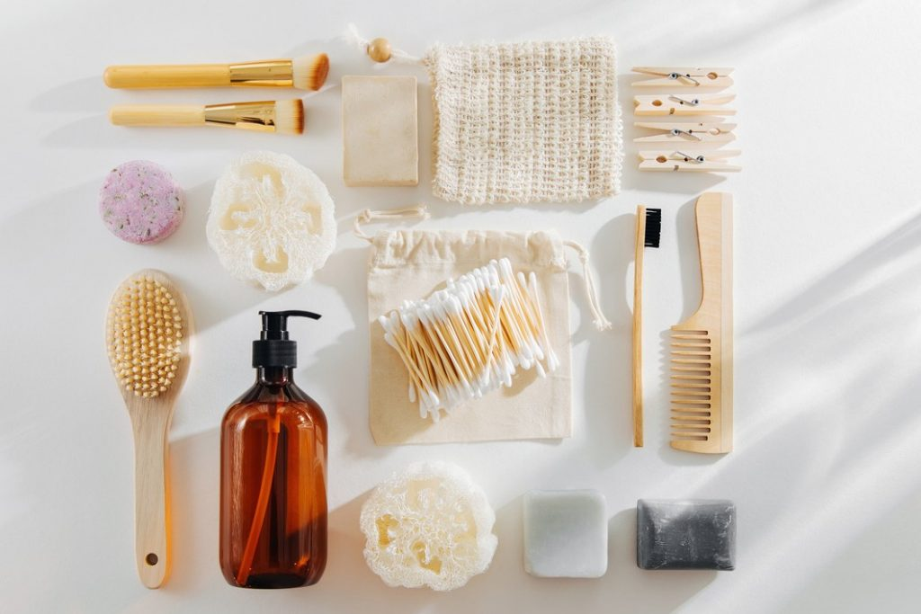 Set of Eco cosmetics products and tools. Soap, Shampoo Bottles, bamboo toothbrush, natural wooden brush. Zero waste, Plastic free. Sustainable lifestyle concept.