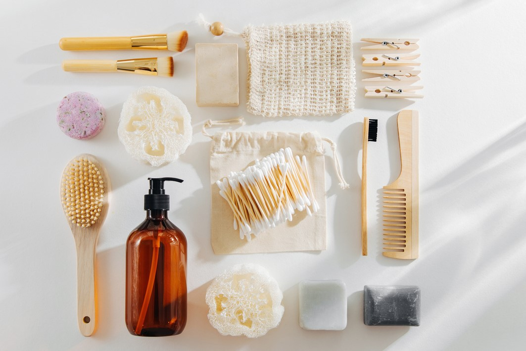 Set of Eco cosmetics products and tools. Soap, Shampoo Bottles, bamboo toothbrush, natural wooden brush. Zero waste, Plastic free. Sustainable lifestyle concept, Eco-friendly