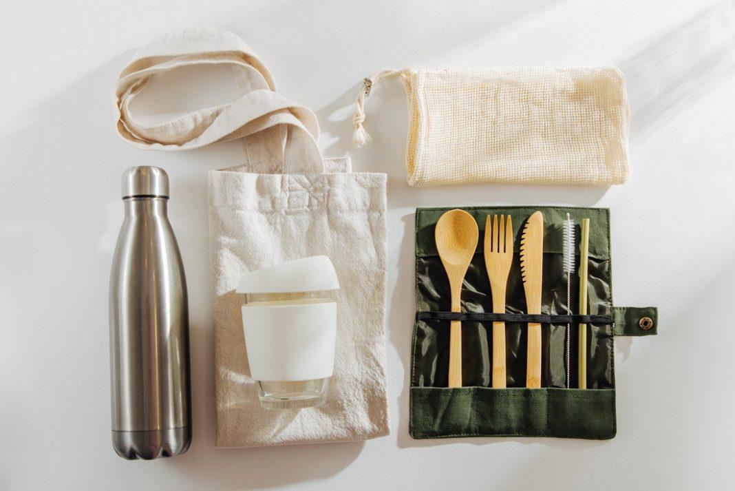 Set of Eco friendly bamboo cutlery, eco bag reusable coffee mug and water bottle. Sustainable lifestyle. zero waste travel