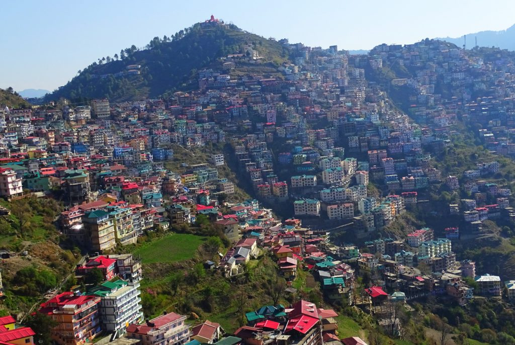 Manali's houses located on hills in state of himachal pradesh in a himalayan mountain range. Manali hotels and colorful houses on hills.