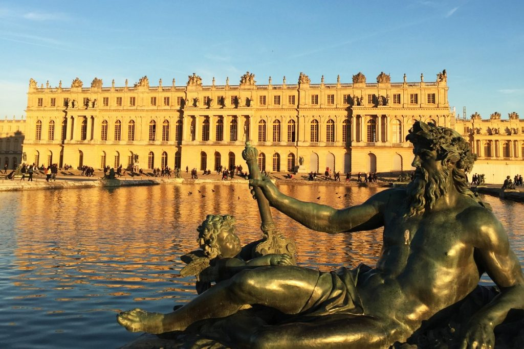 Statue on the Water Parterre Versailles and Palace in background.