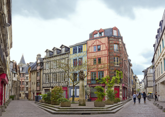 Place Saint-Amand with bust of Claude Monet in Rouen, France, day trips from paris