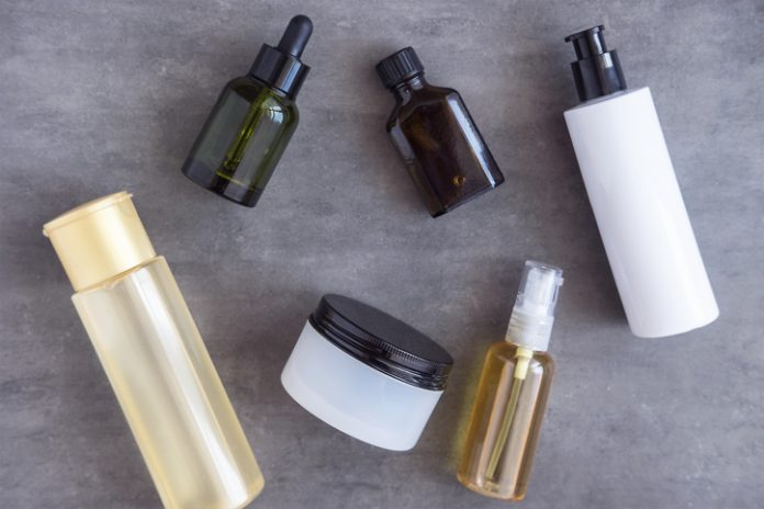 Bottles, tubes and jars with natural skincare beauty products, creams, lotion, serum, toner, oil from above. skincare mistakes