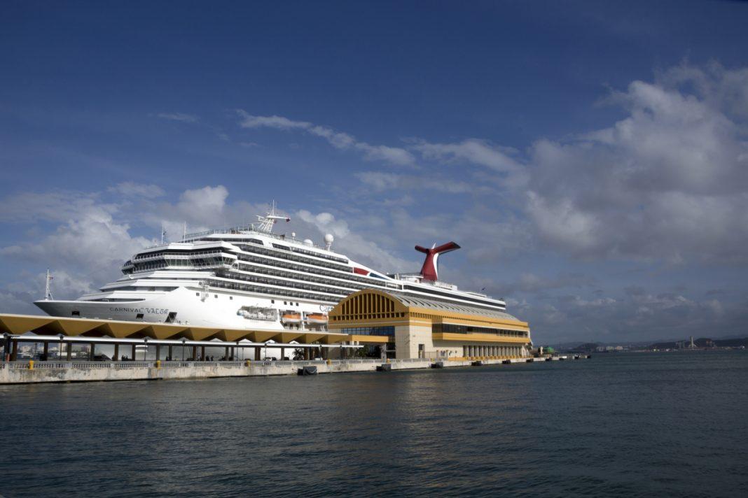 Imposing Carnival Valor Cruise Ship anchored at San Juan harbor