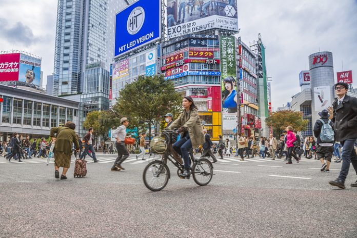 Shibuya crossing, pedestrians and cyclist crossing the road, street level, Game
