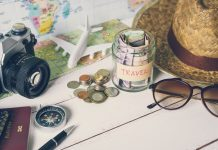 Collecting money for travel with accessories of traveler, Travel concept, budget travel tips