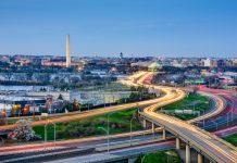 Washington, DC skyline of monuments and highways.
