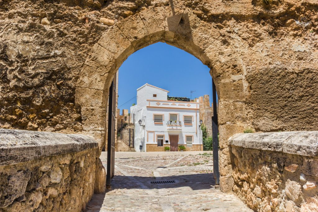 Entrance gate to the castle square in Bunol, Spain