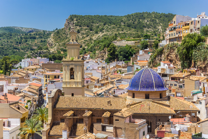 Old church with blue dome in the historic center of Bunol, Spain