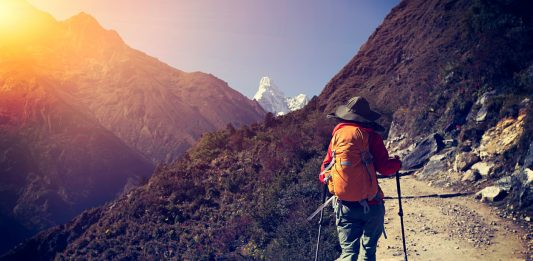 young woman backpacker trekking at the himalaya mountains, Mountain Ranges