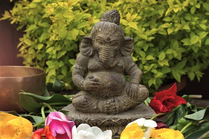 ganesha deity surrounded with flowers
