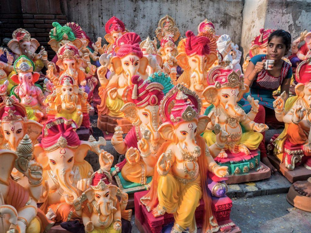 Woman selling ganesha statues for Ganesh Chaturthi India