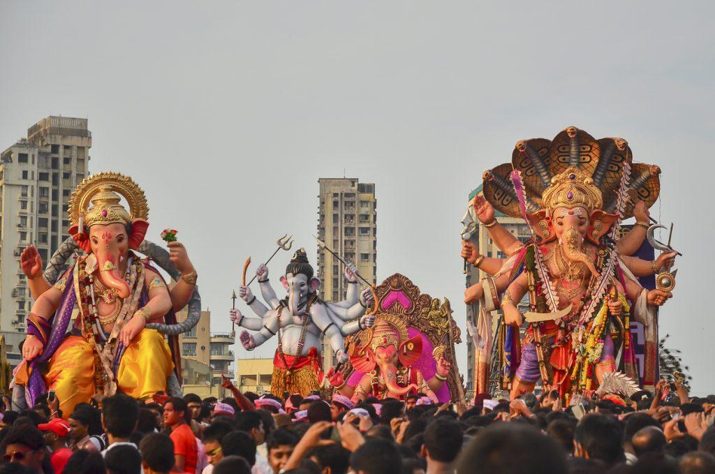 Mumbai, India - September 17, 2013: Devotees bringing Hindu God Ganesha into the ocean during Ganesha Festival
