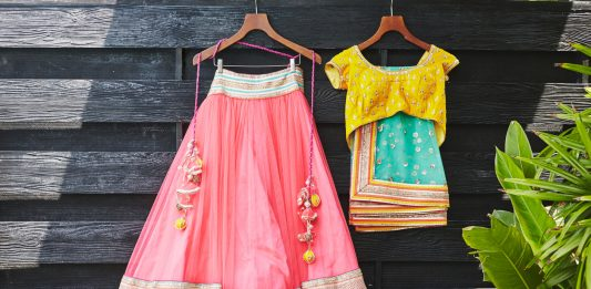 Traditional Indian saree (sari) wedding dress for indian bride and blouse hanging on the wood wall