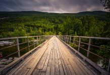 A bridge crossing a river in the countryside of Norway Longest viking bridge