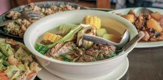 Tasty Philippines dinner meal with bulalo beef marrow and vegetables