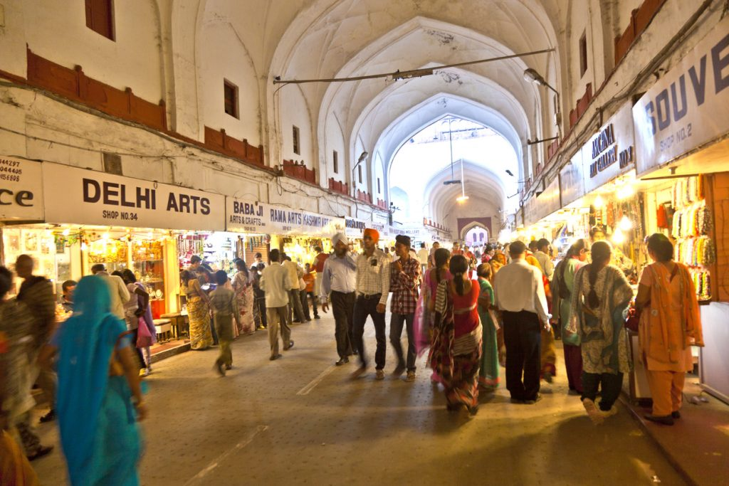 people shop inside the Meena Bazaar, traditional markets in India