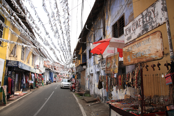 Jew town in Mattancherry, Kochi, Kerala, India. Jew Town in Mattancherry is famous for the antique shops and colonial buildings. Jew Town is a narrow street between Mattancherry Palace and the Synagogue.