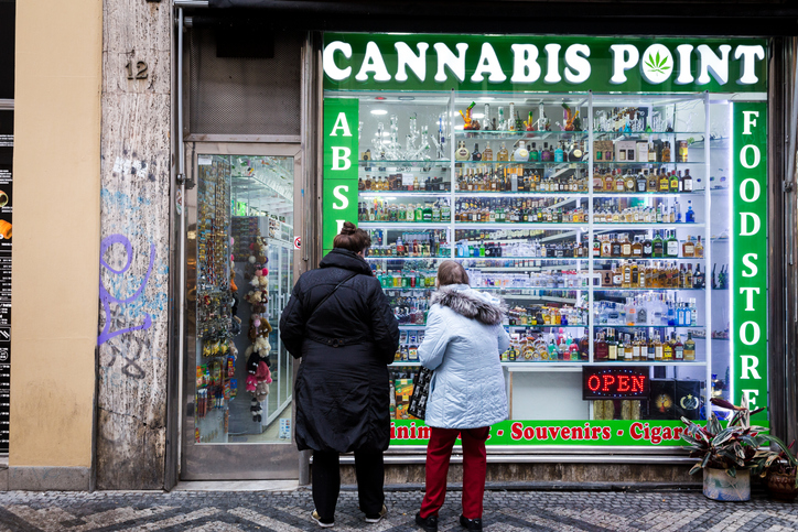 People window shopping at a shop in Prague selling Cannabis