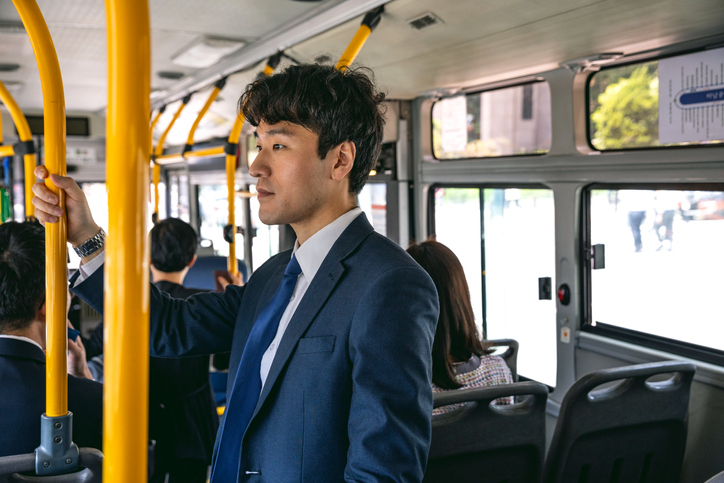Businessman commuting by bus in Seoul - South Korea