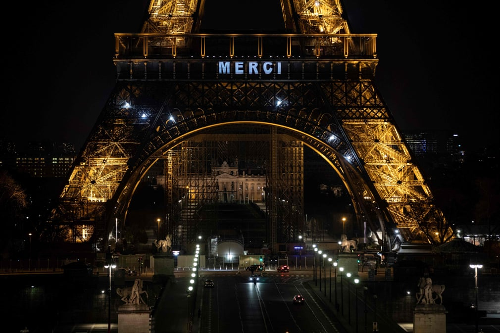 'Merci' is displayed on the Eiffel Tower