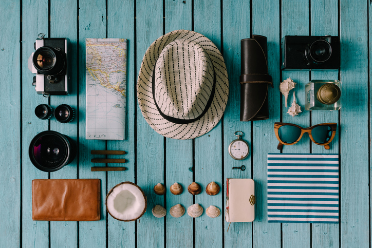 Summer vacation things neatly organised. minimalist travel packing
