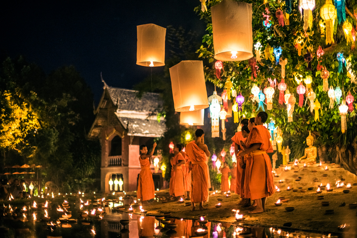 Monks light paper lanterns annually at Wat Phan Tao temple during the Loi Krathong Festival which is among the popular lantern festivals