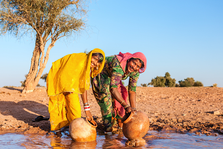 Rajasthani women posing for a photo, what is ecotourism
