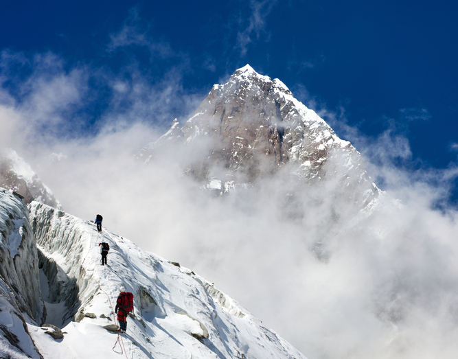 Seven Summits, group of climbers on mountains montage to mount Lhotse, Everest area, Khumbu valley, Nepal