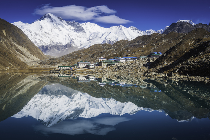 One of the highest peaks in the world, The snow capped peak of Cho Oyu (8201m) towering over the remote Sherpa settlement of Gokyo