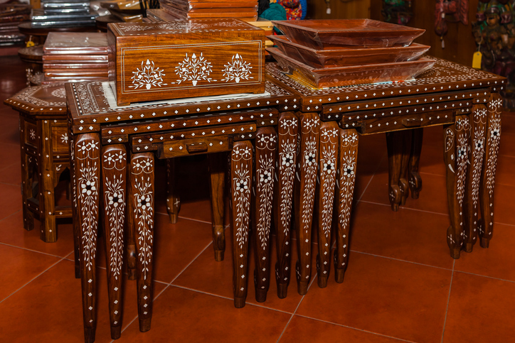 Carved rosewood tables for authentic shopping in Mysore