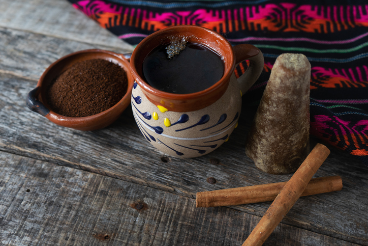 Traditional mexican cup of coffee with cinnamon