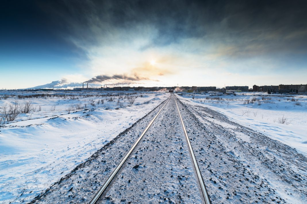 Winter railroad built on permafrost. Norilsk, Taimyr Peninsula one of the coldest cities in the world