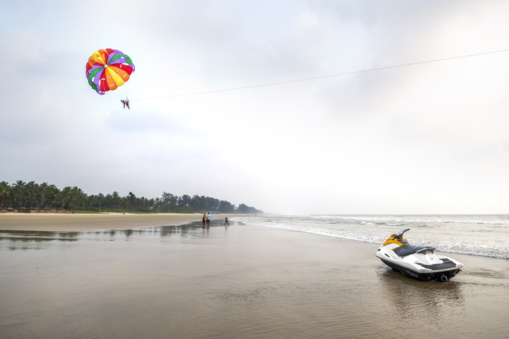 Paraglide lesson on beach with jet-ski in foreground, beaches in south goa