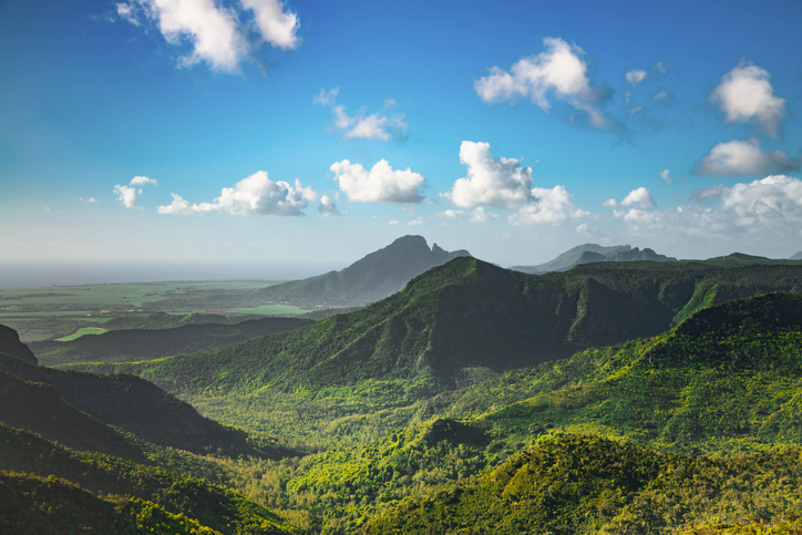 View over tropical Mountain Range Black River Gorges National Park on Mauritius Island under blue summer sky. Gorges Viewpoint, Mauritius, Africa.