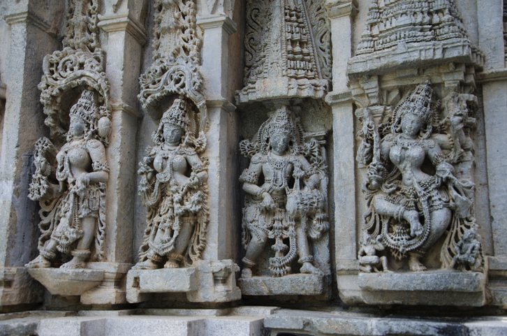 Carved idols on the outer wall of the Paathaaleshwara Temple, Belur, Karnataka, India