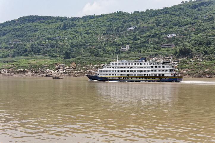 Cruise ship sailing up the Yangtze River on a hazy morning,