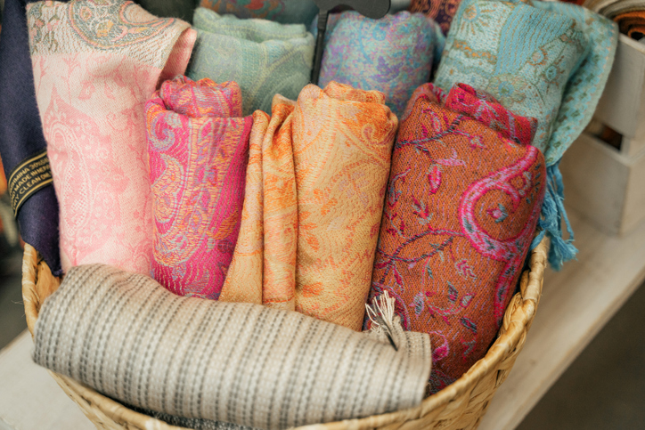 Traditional Indian fabric store. Colorful traditional indian textile fabric wrap scarfs