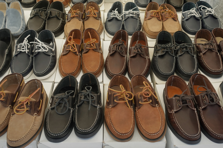Men's leather and suede boat shoes for sale at street market. Casual footwear.