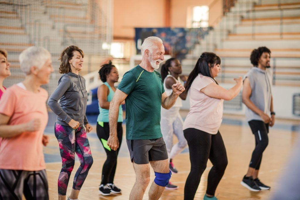 Large group of people dancing at Zumba class